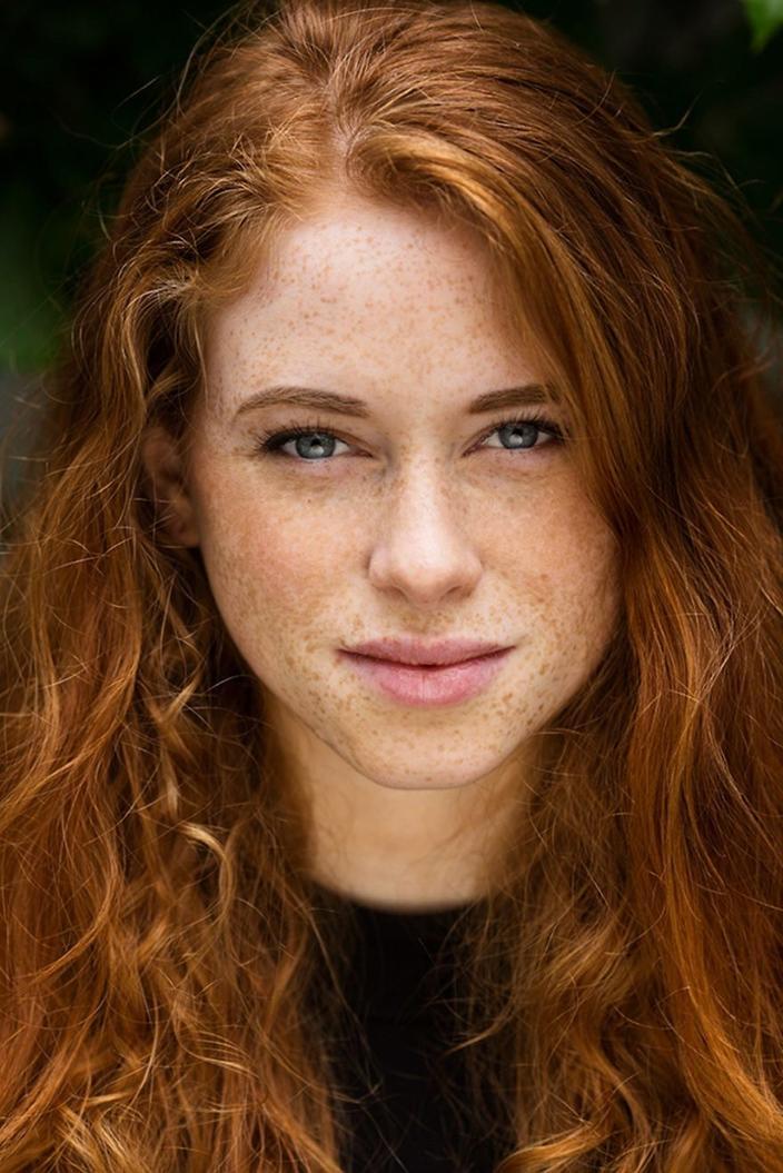 redhead-irish-girl-taking-off-bikini