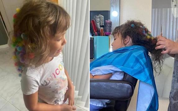 Маленькая девочка запутала в своих волосах мелкие игрушки. Но парикмахер справилась   новая стрижка идет девочке еще больше