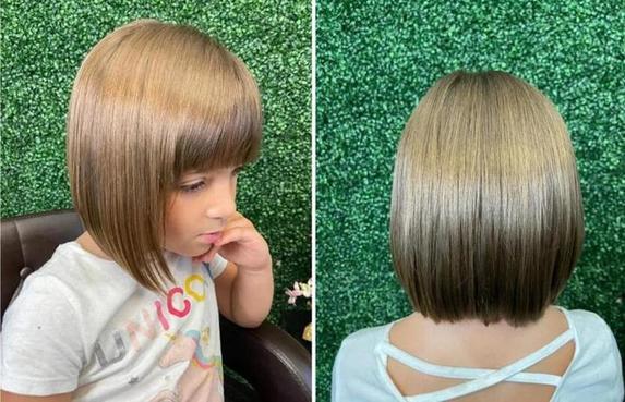 Маленькая девочка запутала в своих волосах мелкие игрушки. Но парикмахер справилась - новая стрижка идет девочке еще больше